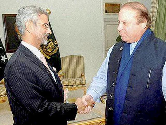 Pakistan Prime Minister Nawaz Sharif and Indian foreign secretary S Jaishankar shake hands in Islamabad.