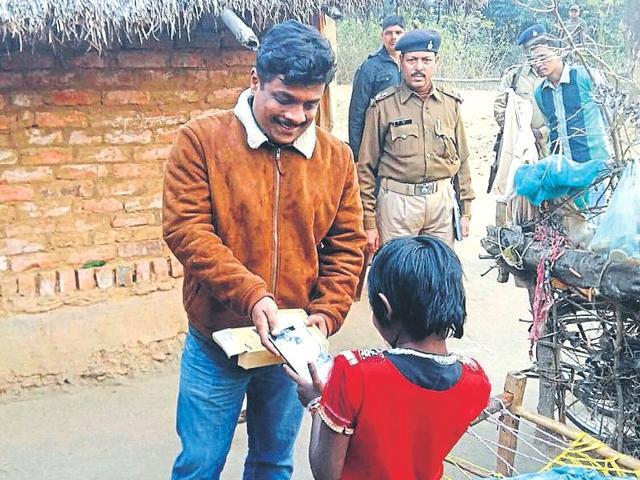 Minor rape survivor gets a tablet from a Mumbai-based philanthropist.
