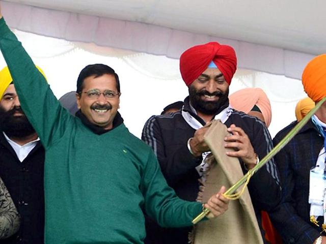 Delhi Chief Minister and AAP convener Arvind Kejriwal is presented a turban by party MP Bhagwant Maan during a party rally in Muktsar on Thursday.