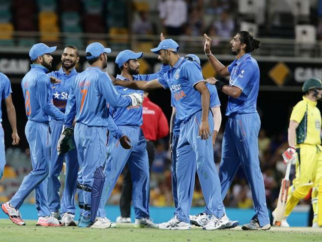 Team India players celebrate the wicket of Shaun Marsh.