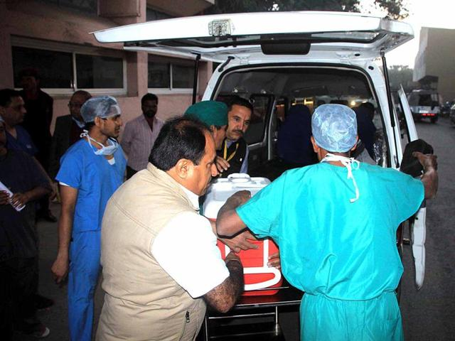Organs of a 59-year-old being carried to the ambulance for transplant at Bombay hospital.