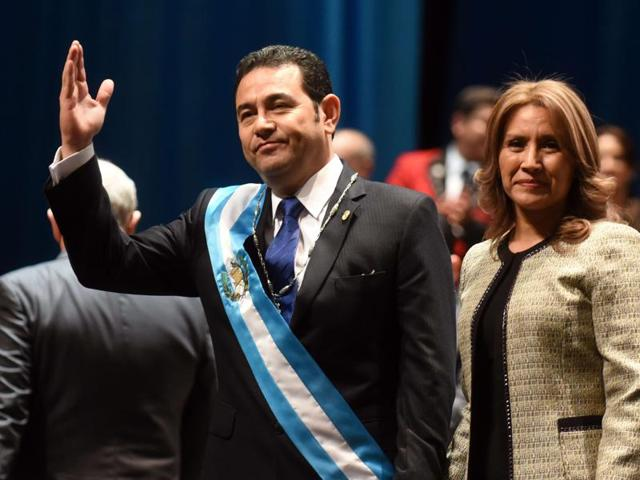 Guatemalan new President Jimmy Morales (L) waves next to his wife Gilda Marroquin during the inauguration ceremony in Guatemala City.