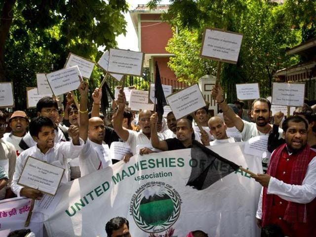 Nepalese men, mostly from Madhesi community, protest against the new constitution outside the Nepalese embassy in New Delhi. A recent report in China's GLobal Times warned the country to avoid interfering with India's relationship with Nepal.