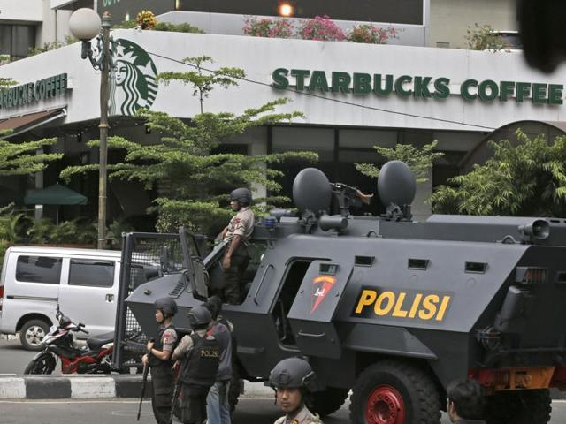 A police armoured vehicle is parked outside a Starbucks Cafe near where an explosion went off in Jakarta, Indonesia.
