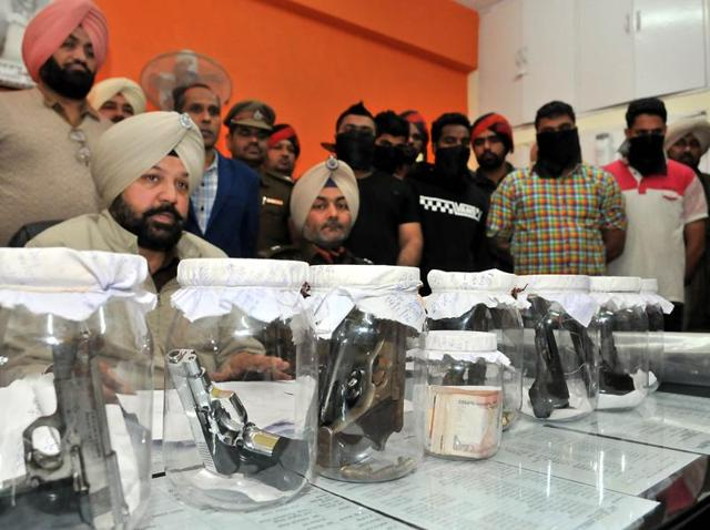 The district rural police on Friday arrested seven gangsters belonging to the Sukha Kahlwan gang and seized nine illegal pistols, a .12 bore rifle, 62 live cartridges, a Mahindra Scorpio and three bikes from them.