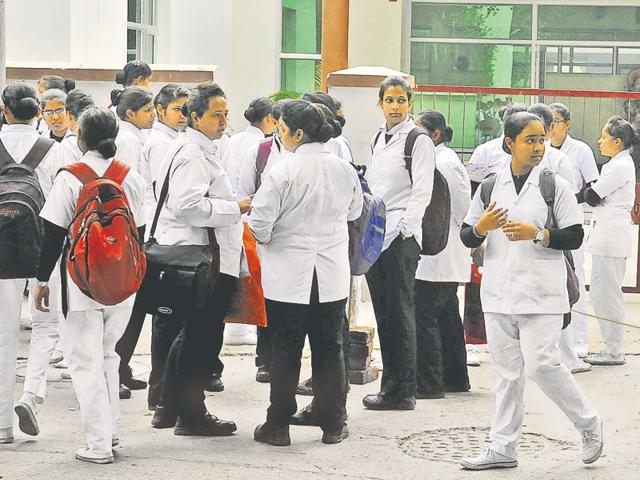 Nursing students outside their college in Jalandhar on Thursday.