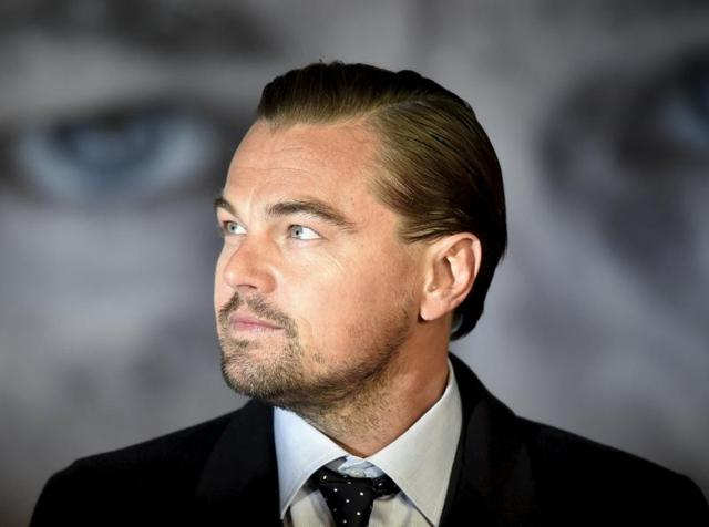 Actor Leonardo DiCaprio poses as he arrives for the British premiere of The Revenant. DiCaprio has been nominated for the Best Actor Oscar.