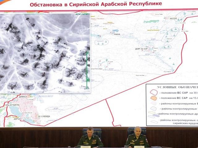 Chief of the Main Operational Directorate of the General Staff of the Russian Armed Forces lieutenant general Sergei Rudskoy (R) and spokesman for the Russian Defence Ministry major general Igor Konashenkov attend a briefing in Moscow. Country's defence ministry said on Friday a new objective of Russian forces in Syria was to provide humanitarian aid.