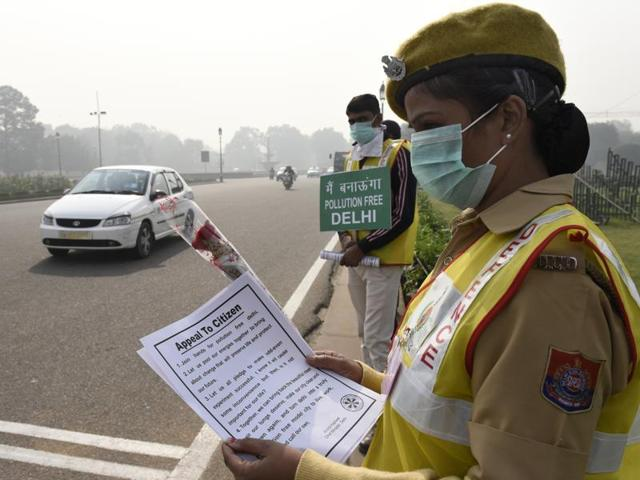 Civil Defence personnel in Delhi promote odd, even plan in  Delhi. Bombay HC wants to know if the scheme can work in the western city.
