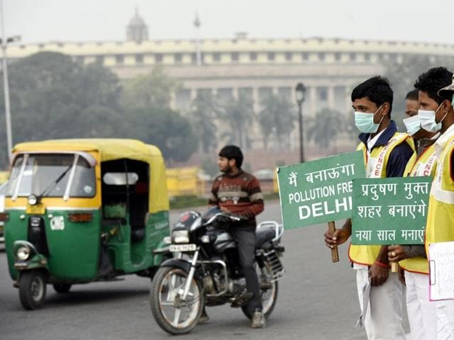 Civil Defence volunteers hold placards promote the odd, even plan in front of Parliament.  HT survey finds overwhelming support for