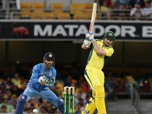 Australia's Shaun Marsh, right, plays a shot past India's wicket keeper MS Dhoni, left, during the second ODI between Australia and India in Brisbane on January 15, 2016.