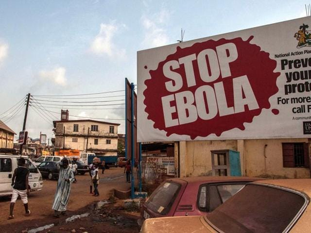 A  banner reading 'STOP EBOLA' forming part of Sierra Leone's Ebola free campaign in the city of Freetown, Sierra Leone, Friday, Jan. 15, 2016. A corpse has tested positive for Ebola in Sierra Leone, an official said Friday.