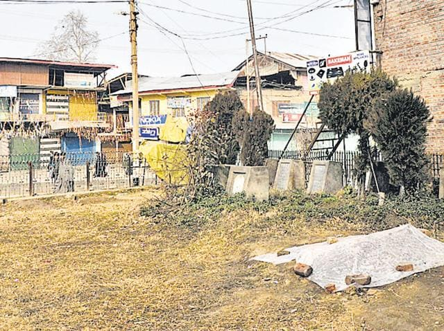 The grave of Omais Ahmad Sheikh at Shaheed Park in Pulwama. The town, which has remained shut for the last 14 days, is set to reopen.