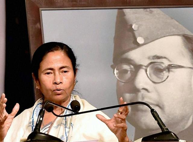 West Bengal Chief Minister Mamata Banerjee with niece of Netaji Subash Chandra Bose, Krishna Bose standing near Netaji's car at a programme to mark the 75th anniversary of the freedom fighter's