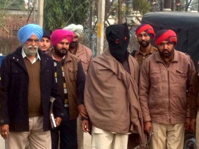 Police officials presenting the alleged killer of Pundit Inder Lal before media persons at Tarn Taran on Saturday.