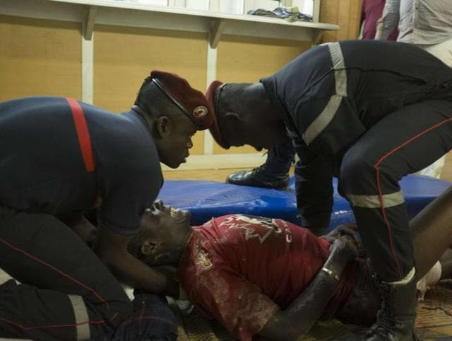 French gendarmes tend to wounded people in the surrounding of the hotel Splendide and the café Cappuccino during the attack on Friday.