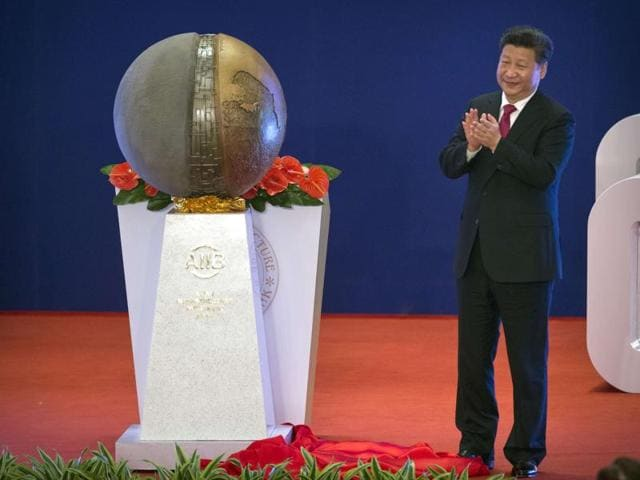 Chinese President Xi Jinping applauds after unveiling a sculpture during the opening ceremony of the Asian Infrastructure Investment Bank (AIIB) in Beijing Saturday.