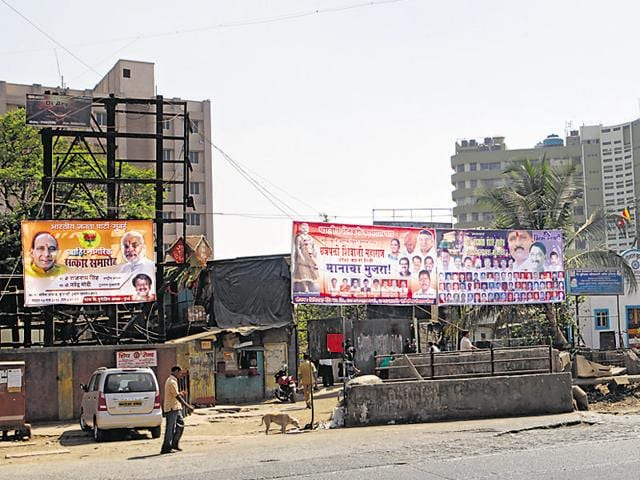 Illegal hoarding near Priyadarsini circle, Sion.