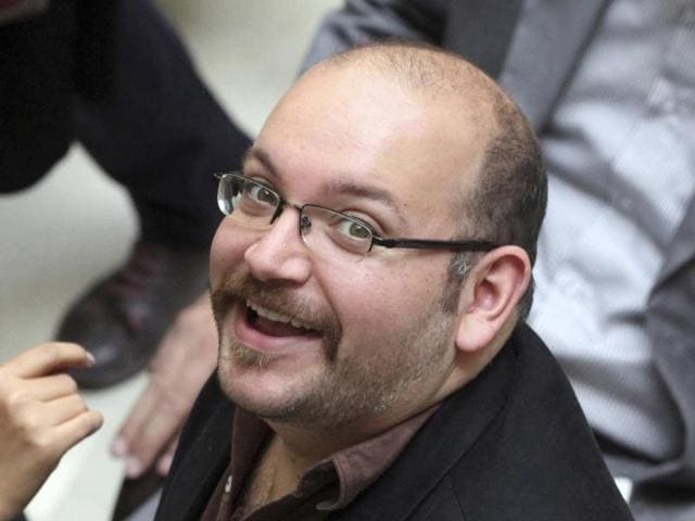 In this file photo, Jason Rezaian, an Iranian-American correspondent for the Washington Post, smiles as he attends a presidential campaign of President Hassan Rouhani in Tehran. Iranian state television announced on Saturday that the government has freed four dual-nationality prisoners, and a person close to Iran's judiciary is confirming to The Associated Press that Washington Post reporter Jason Rezaian is one of them.
