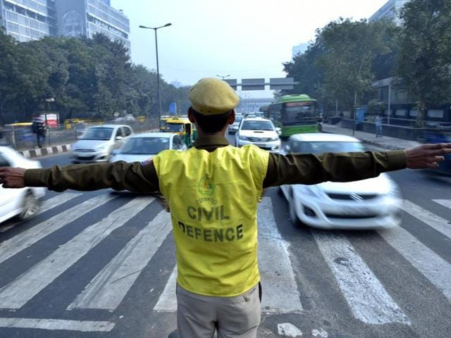 Civil defence volunteer during the Odd-Even trial at ITO in New Delhi.