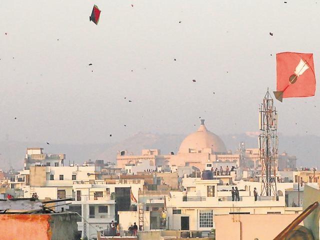 Kites dot the Jaipur sky on Makar Sankranti evening on Friday.