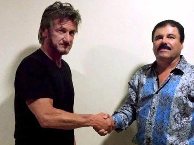 Actor Sean Penn (L) shakes hands with Mexican drug lord Joaquin