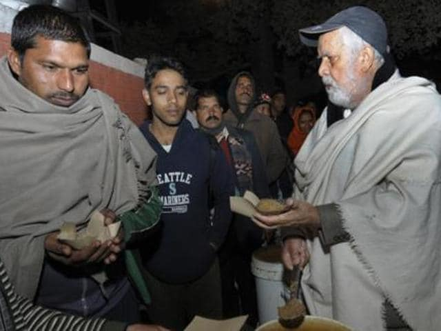 """Jagdish Lal Ahuja, popularly known as the 'Baba' who distributes free food, has decided to change his mind and will carry on with the langar """"till his last breath""""."""