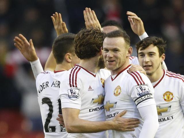 Wayne Rooney celebrates at full time with teammates.