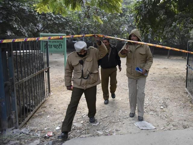 Delhi Police personnel at the crime scene where a sub-inspector shot a woman dead before committing suicide.