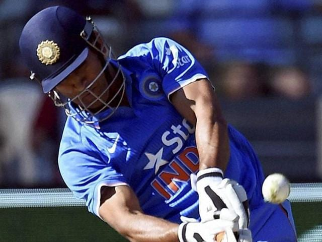 India's MS Dhoni hits a six against Australia during their one day international cricket match in Melbourne.