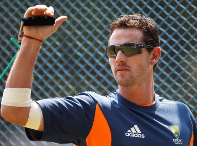 Australia paceman Kane Richardson celebrates the wicket of India's batsman Rohit Sharma in Melbourne.