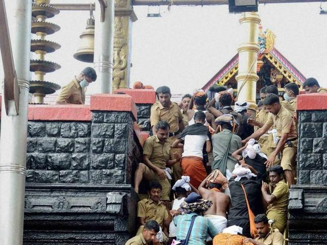 Police help devotees seeking a glimpse of Lord Ayyappa at Sabarimala in this file photo.