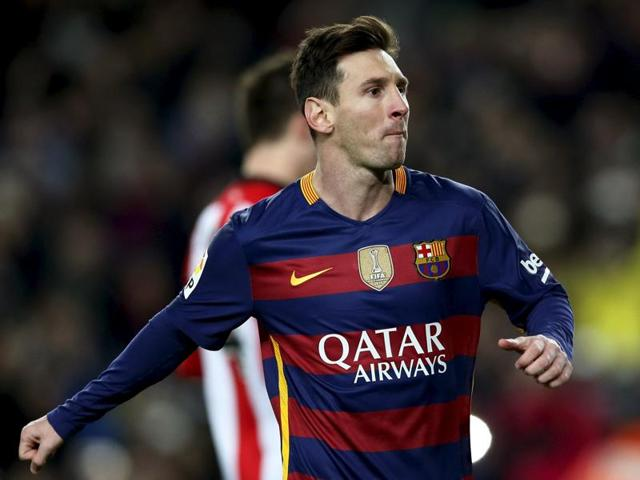 Barcelona's Lionel Messi celebrates the opening goal against Athletic Bilbao during the La Liga game at the Camp Nou Stadium in Barcelona on January 17, 2016.