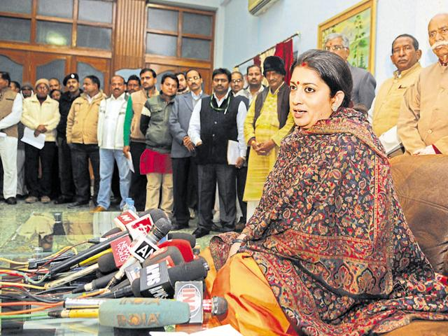 Union Minister Smriti Irani interacts with media personnel in Amethi on Sunday.