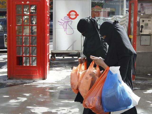 Women wear full-face veils as they shop in London in this file photo. Some migrants to Britain who cannot pass an English test within 2-1/2 years of arriving may not be allowed to stay, British Prime Minister David Cameron said on Monday.
