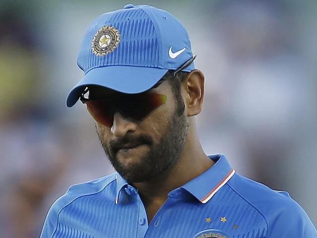 India's MS Dhoni walks back to his wicket keeping position during their one day international cricket match against Australia.