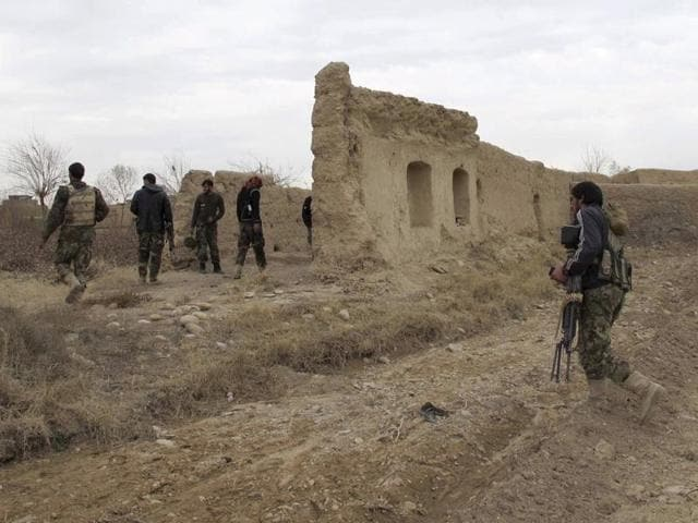 Afghan National Army (ANA) soldiers patrol at an outpost in Helmand province, Afghanistan.