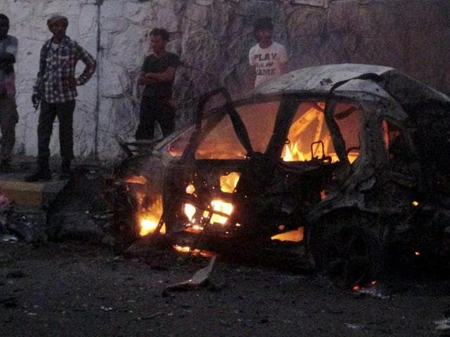A car burns at the site of a car bomb attack outside the house of the director of security for Yemen's southern port city of Aden, Brigadier General Shalal Ali Shayyeh, in Aden January 17, 2016.