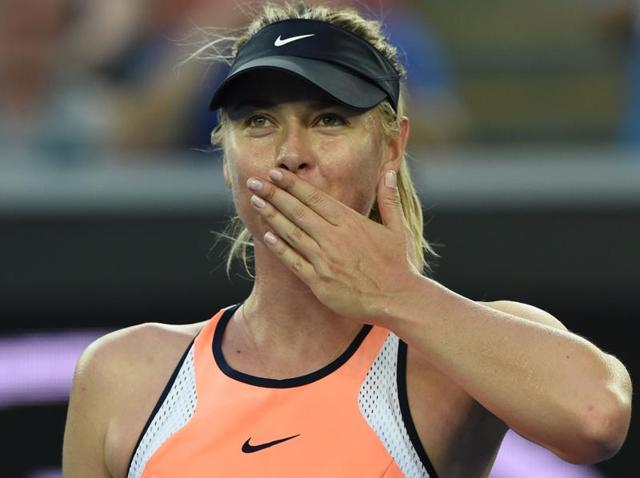 Russia's Maria Sharapova blows a kiss to spectators after victory in her women's singles match against Japan's Nao Hibino on day one of the 2016 Australian Open in Melbourne on January 18, 2016.