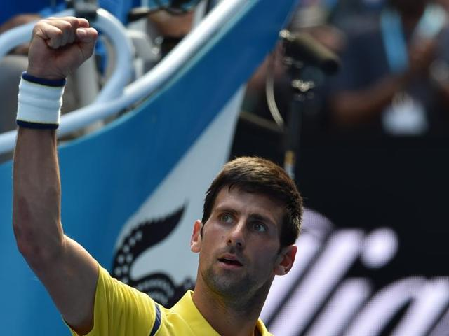 Serbia's Novak Djokovic celebrates after victory in his men's singles match against South Korea's Chung Hyeon on day one of the 2016 Australian Open in Melbourne on January 18, 2016.