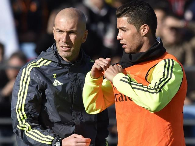 Real Madrid's new French coach and Cristiano Ronaldo gesture during his first training session as coach of Real Madrid at the Alfredo di Stefano Stadium.