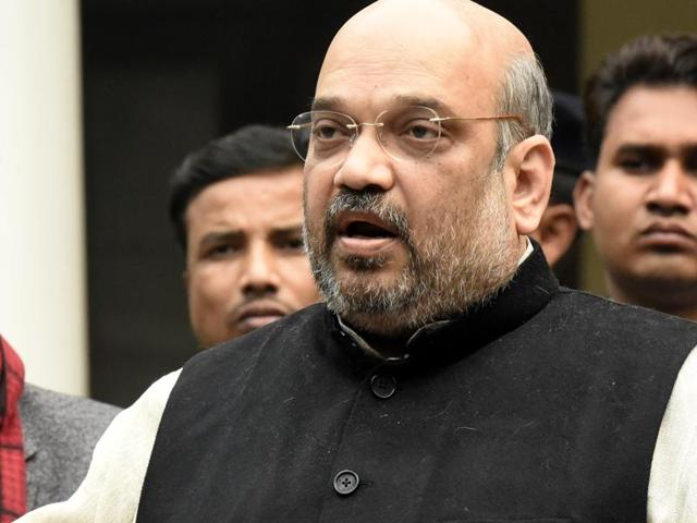 BJP president Amit Shah addresses media persons at his residence in New Delhi.