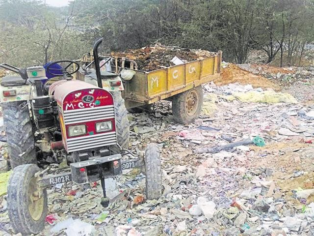 The activists alleged that construction waste from the Gurgaon- Faridabad road, which was being cleared ahead of the PM's visit to the city, was dumped on forest land.