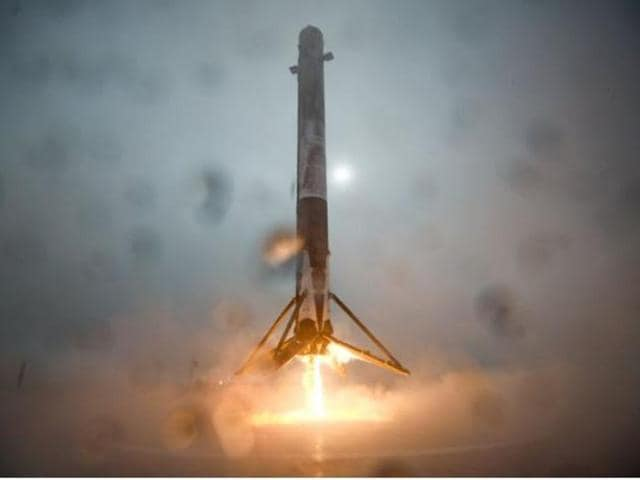 First stage of SpaceX's Falcon9 approaches center of landing droneship in Pacific on Monday. One of the support legs broke during the landing on an ocean barge and finally toppled over.