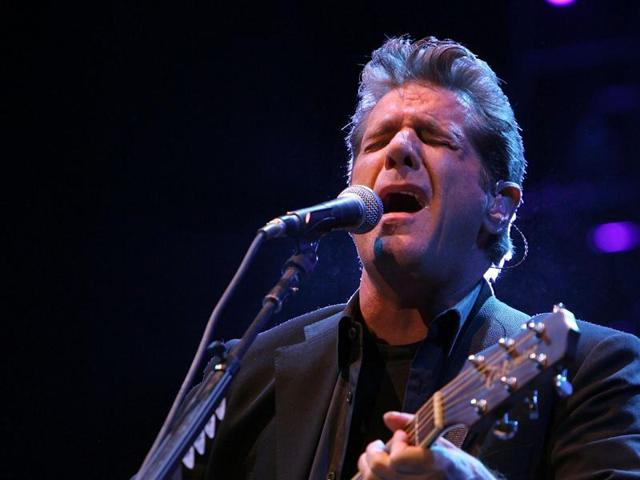 Don Henley, Glenn Frey, and Joe Walsh of the Eagles harmonize during their opening number to a sold out crowd at the American Airlines Center in Dallas, July 28, 2001.