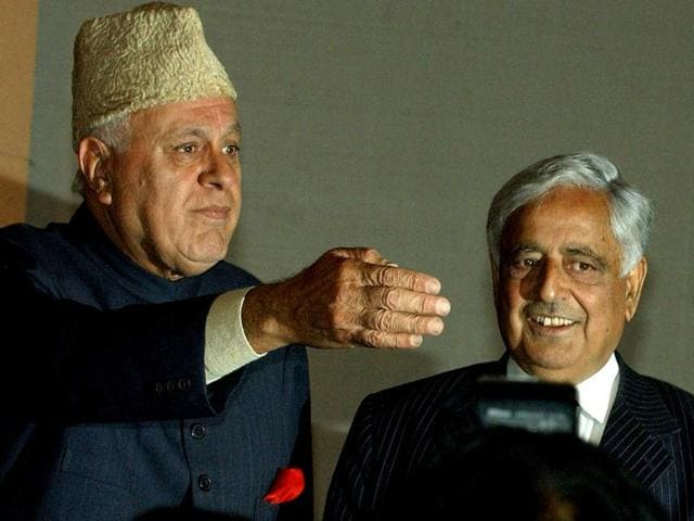 A 2005 file photo of National Conference leader Farooq Abdullah (L) and Mufti Mohammad Sayeed (C). Abdullah said late Mufti's daughter and PDP leader Mehbooba should continue the alliance with BJP to form a government with Kashmir.