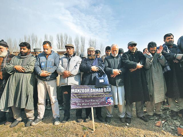 Men offer funeral prayers in absentia of Manzoor Ahmad Dar, 14 years after his disappearance on the outskirts of Srinagar.