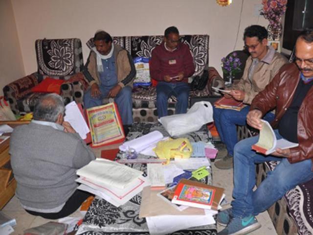 Lokayukta sleuths examining documents at the house of cooperative manager Basantilal Sharma in Ujjain on Tuesday.