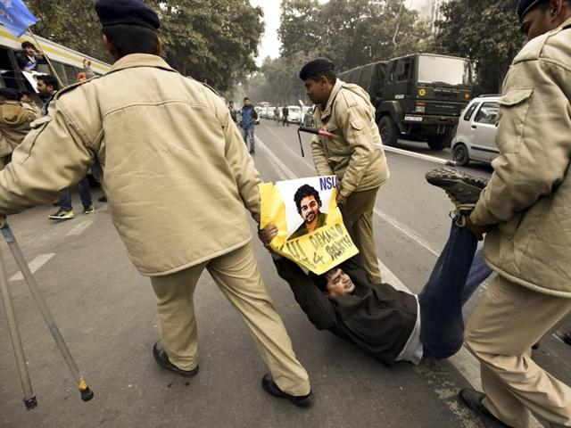 A protester in Delhi shouts slogans against Minister Bandaru Dattatreya at a demonstration in support of Dalit scholar Rohith Vemula.