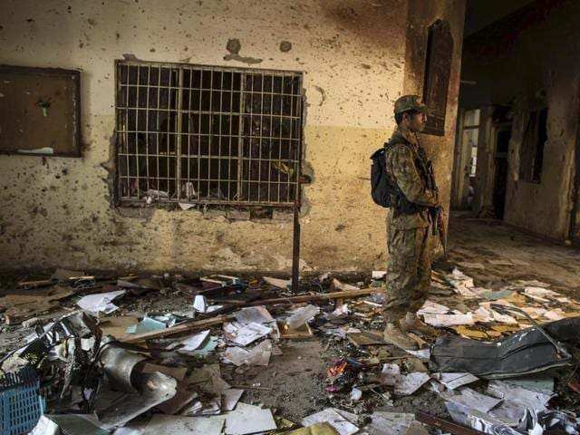 A file photo shows a soldier standing in the Army Public School, which was attacked by Taliban gunmen, in Peshawar.